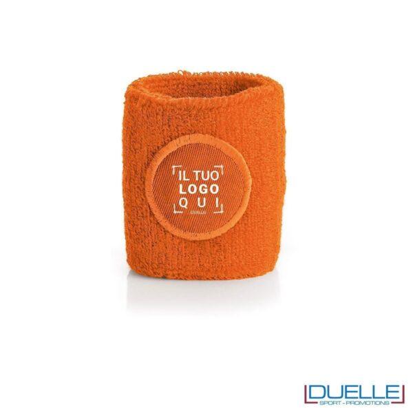 polsino tergisudore personalizzato in colore arancione, gadget sportivi personalizzati