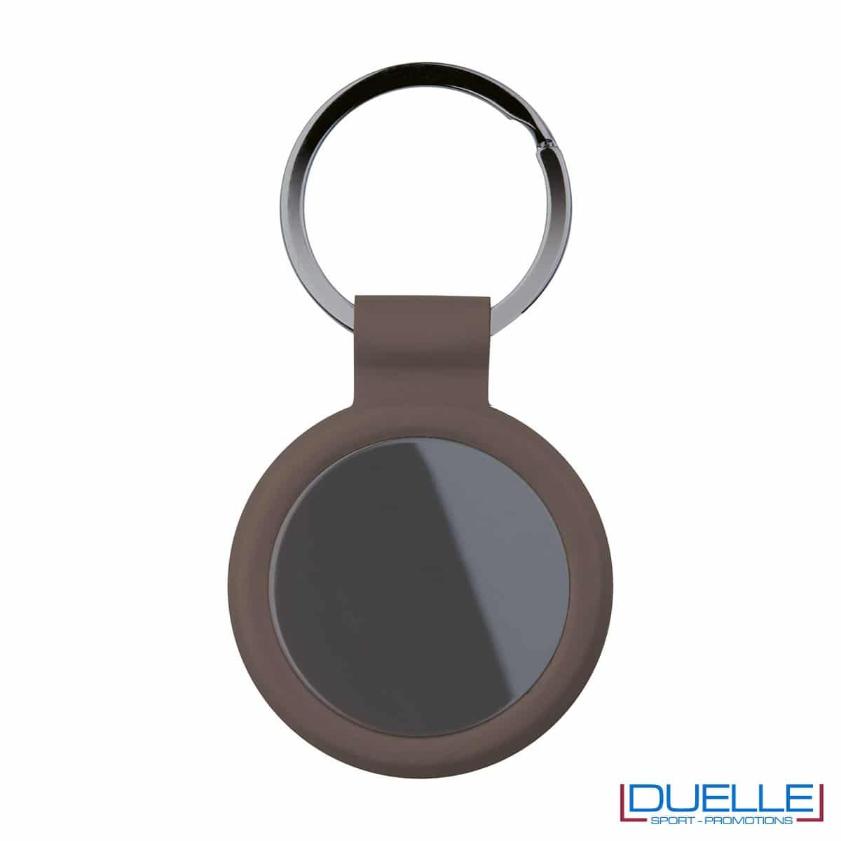portachiavi personalizzato circolare in metallo gun metal con profilo marrone